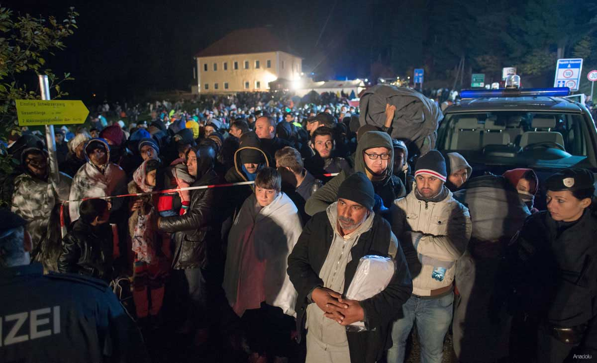 Refugees wait at the border between Austria and Germany, on October 28, 2015 near Kollerschlag, Austria
