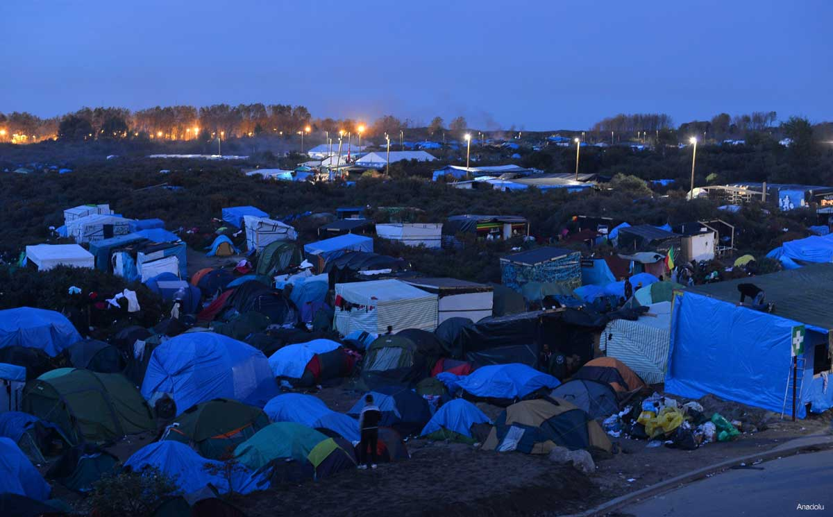The Jungle refugee camp at night, Paris France