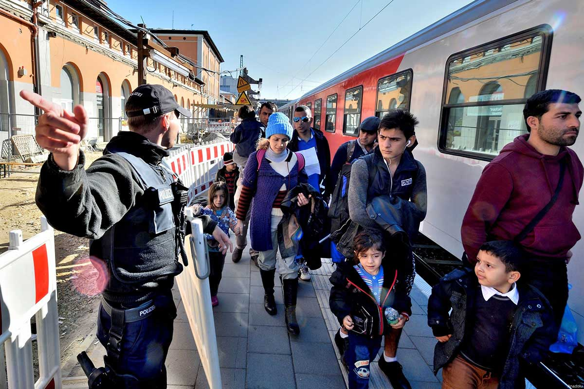 Refugees are seen arriving on train in the South East German town of Passau. Among the EU states, Germany faces the biggest refugee influx, as authorities expect a record 800,000 asylum applications this year, four times the last year's total.
