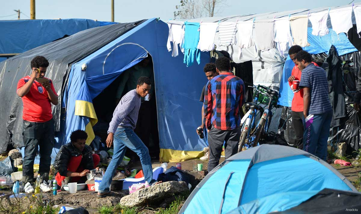 Refugees trying to reach the UK, shelter at a refugee camp, also known as the Jungle, in the northern port city of Calais, France on October 25, 2015