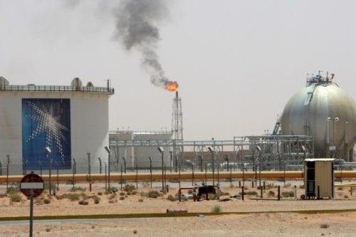 A gas flame is seen in the desert near the Khurais oilfield, about 160 km (99 miles) from Riyadh, Saudi Arabia [REUTERS/Ali Jarekji/File Photo]