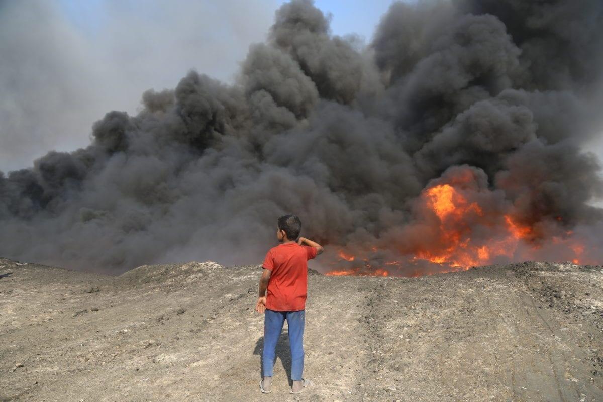 Smoke rises after Daesh terrorists attack oil wells in Iraq on October 16, 2016, Nineveh, Iraq. ( Hemn Baban - Anadolu Agency )