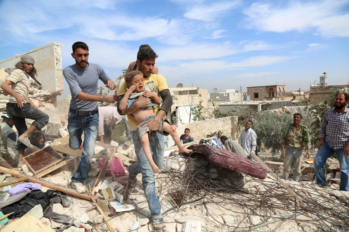 ALEPPO, SYRIA - OCTOBER 17: Syrians clear debris to rescue people from a wreckage after war crafts belonging to the Russian army carried out an airstrike over opposition controlled residential areas in Aleppo, Syria on October 17, 2016. ( Ahmed al Ahmed - Anadolu Agency )