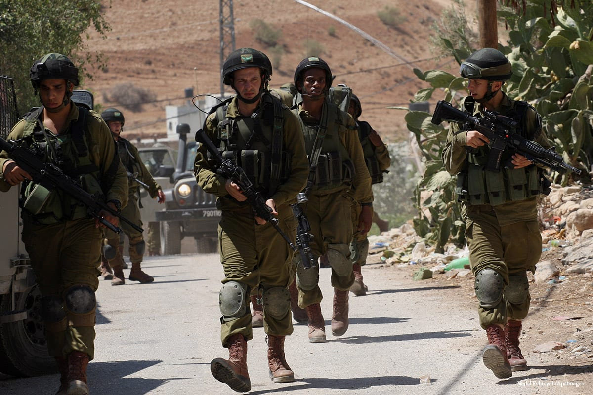 Israeli military patrol the streets in West Bank on 4th September 2014 [Nedal Eshtayah/Apaimages]