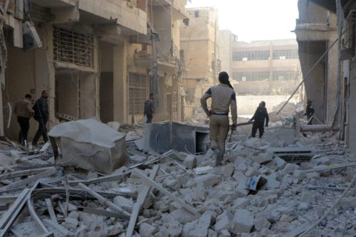 Debris of the collapsed buildings are seen after the Syrian and Russian armies carried out airstrikes on the residential areas in Aleppo, Syria on 23 November 2016 [Ibrahim Ebu Leys / Anadolu Agency]