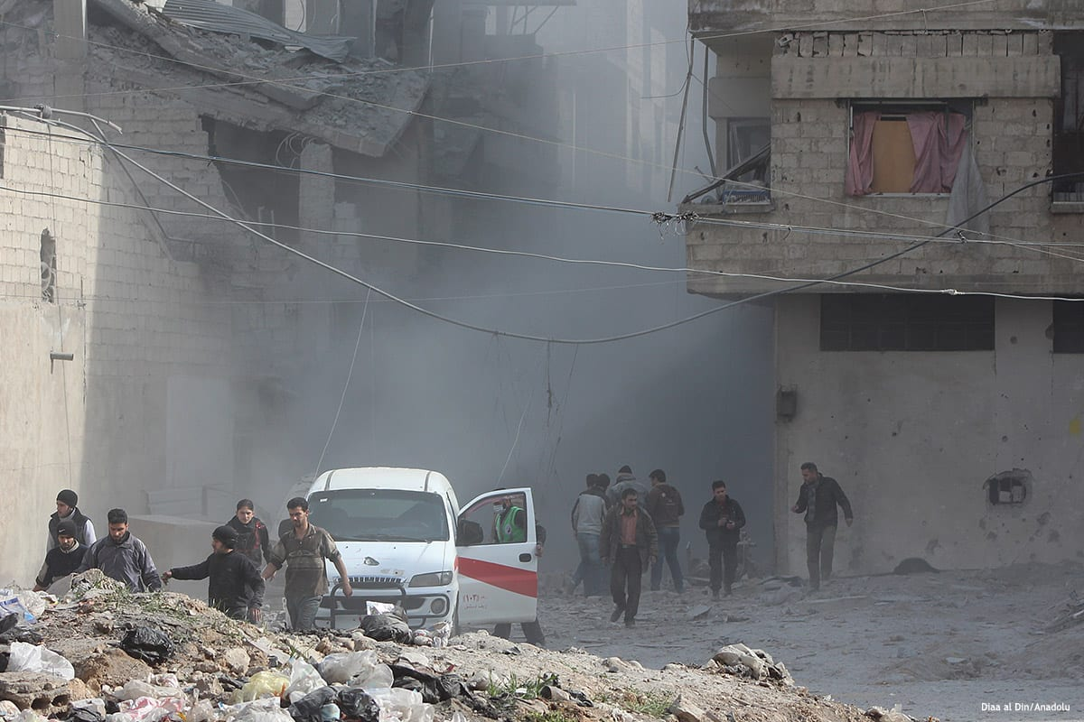 Syrians and civil defence team members carry out search and rescue operations after Assad Regime forces carried out airstrikes in a marketplace in Damascus, Syria on January 25 2017 [ Diaa al Din/Anadolu]