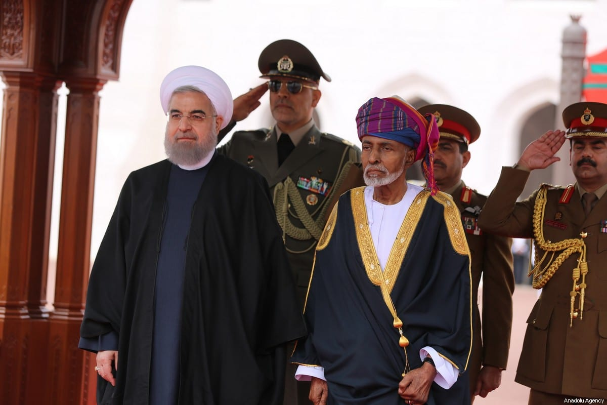 Iran's President Hassan Rouhani (L) is welcomed by Oman's Sultan Qaboos Bin Said Al Said (C) with official welcome ceremony before their meeting in Muscat, Oman on February 15, 2017 [Presidency of Iran / Handout - Anadolu Agency]