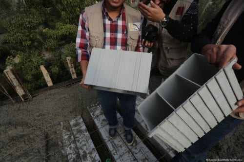 Engineers turn recycled plastic waste materials into bricks used for roofing in Gaza [Mohammed Asad/Middle East Monitor]