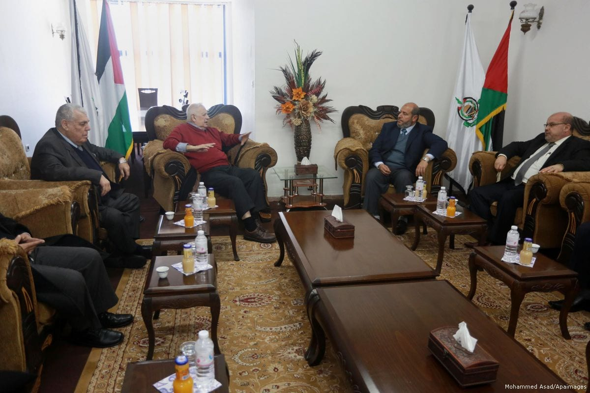 Palestinian chief of Election Commissioner, Hanna Nasser meets with members of Hamas leaders in Gaza on February 15, 2017 [Mohammed Asad/Apaimages]