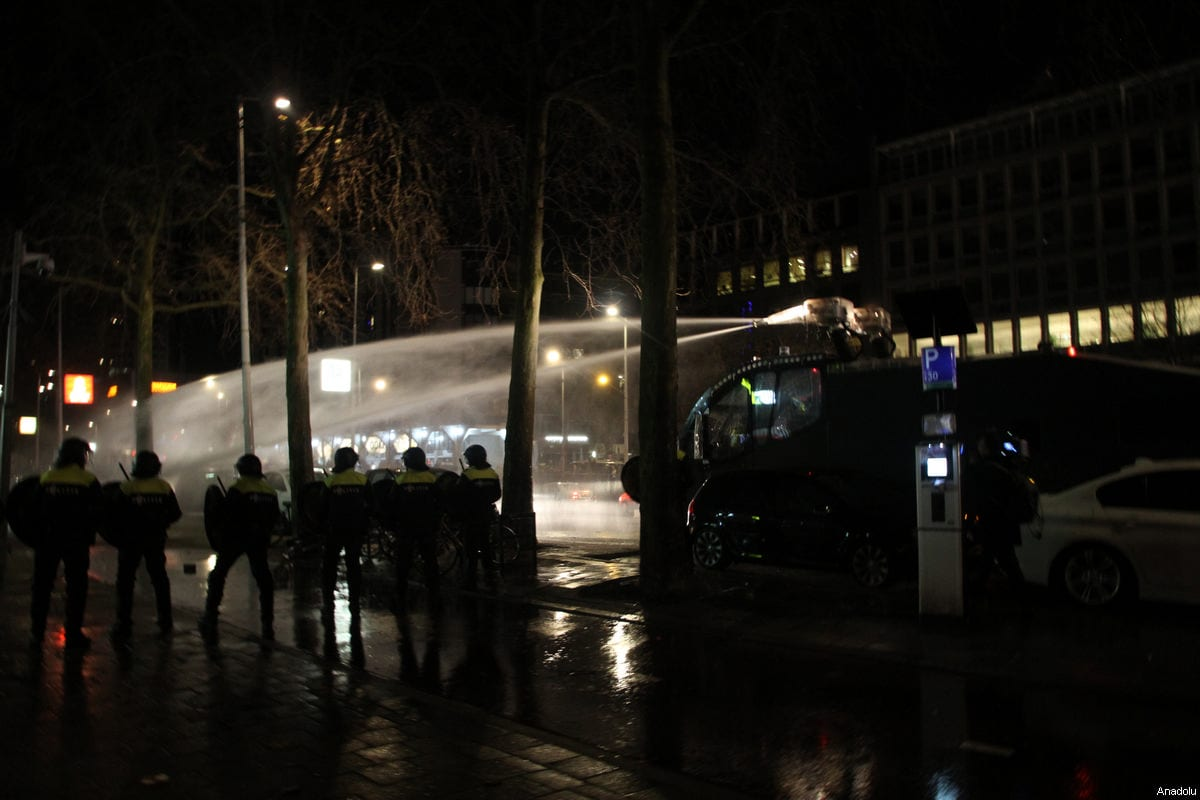 Dutch police use water cannon to disperse Turkish citizens gathering outside Turkish consulate in Rotterdam to protest Dutch government after its ban on ministers, in Rotterdam, Netherlands on March 12, 2017 [Mesut Zeyrek / Anadolu Agency]
