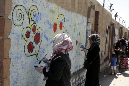 Yemeni women draw paintings on the wall of University of Sana'a to react to the ongoing war in the country in Sana'a, Yemen on 15 March, 2017 [Mohammed Hamoud/Anadolu Agency]