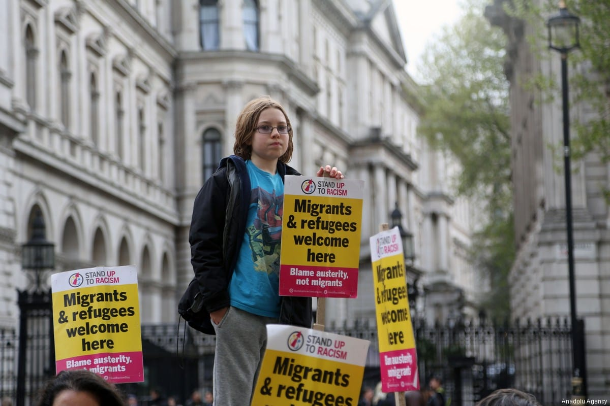 People stage an anti-racism protest, demanding that immigrants who have been waiting at Dunkirk refugee camp to enter England. The protest took place in front of No 10 Downing Street in London, England, UK on 13 April, 2017.( Tayfun Salcı - Anadolu Agency )