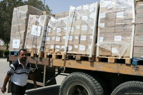 A convoy carrying medical and food in aid in Gaza on 18 July 2014 [Hatem Omar/Apaimages]