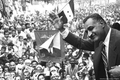 Former Egyptian President Gamal Abdel Nasser waves to crowds in Mansoura from a train car on 7 May 1960 [Bibliotheca Alexandrina/Wikipedia]