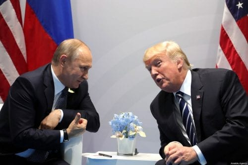 Russian President Vladimir Putin (L) and US President Donald Trump (R) in Hamburg, Germany, on 7 July 2017 [Russian Presidential Press and Information Office/Anadolu Agency ]
