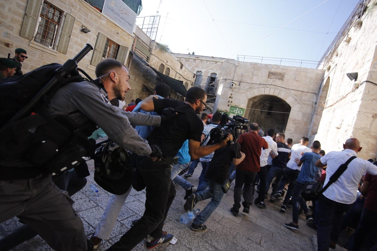 Israeli policemen intervene Palestinians who protest in front Al-Aqsa compound in Jerusalem' after metal detectors were placed at the entrances of Al-Aqsa by Israel, on 16 July 2017 [Mostafa Alkharouf/Anadolu Agency]
