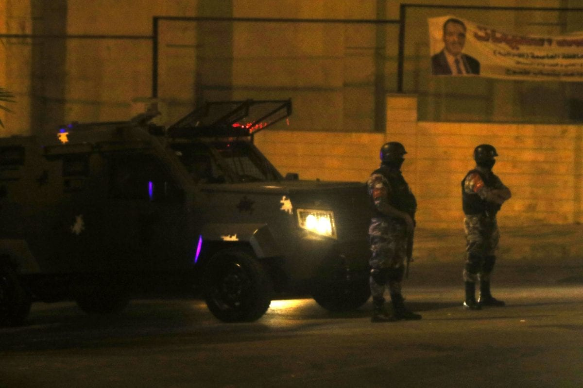 Jordanian security forces are seen as they sealed off the scene and blocked entries to the area after two Jordanians were killed and an Israeli was injured in a violent incident at the Israeli embassy in Jordan on July 23, 2017. Security forces opened fire when a Jordanian national reportedly stabbed an Israeli personnel at the embassy in Amman, said security sources. [Salah Malkawi/Anadolu Agency]