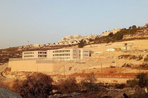 The new Makor Chaim campus under construction, with Neve Daniel settlement in the background [provided to author]