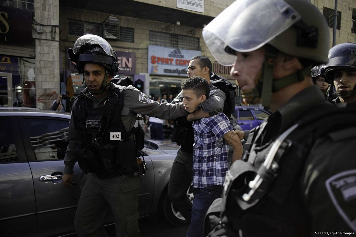 A Palestinian child is being arrested by Israeli security forces [Saeed Qaq/Apaimages]