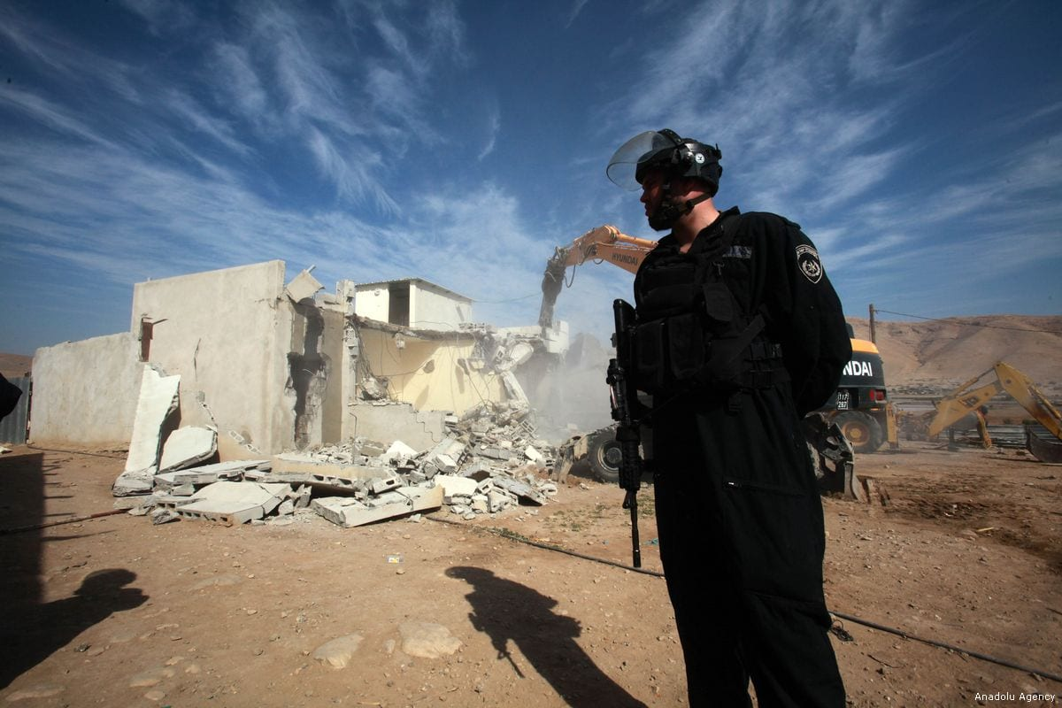 An Israeli security force member guards the area during the demolition of a Palestinian family's house at a farm in north of Jordan Valley in Tubas, West Bank on November 07, 2017. [Nedal Eshtayah - Anadolu Agency]