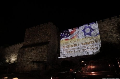 The flags of Israel and the US are reflected by Israeli authorities on western parts of the historical walls around the Old City of occupied Jerusalem to mark US President Donald Trump's speech regarding the recognition of Jerusalem as Israel's capital on 6 December, 2017 [Mostafa Alkharouf/Anadolu Agency]