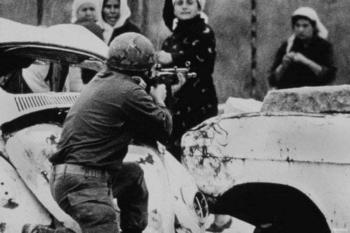 Palestinian women confront Israeli soldiers during the First Intifada [Facebook]