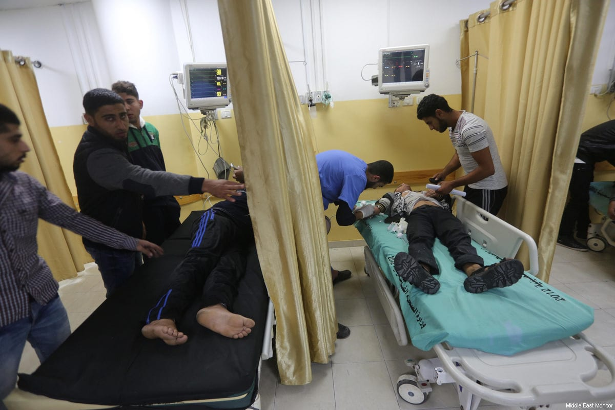 Wounded Palestinians seen after Israeli occupation forces hit the wall surrounding the Indonesian Hospital in Gaza during a F-16 air strike