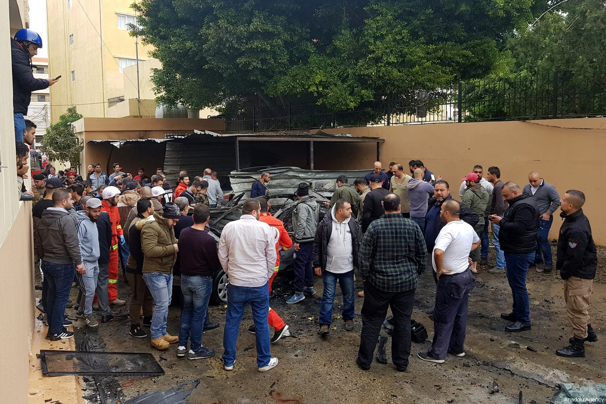 People inspect the parked vehicle belonging to Muhammed Hamdan who is allegedly member of Hamas after it exploded in Sidon Lebanon