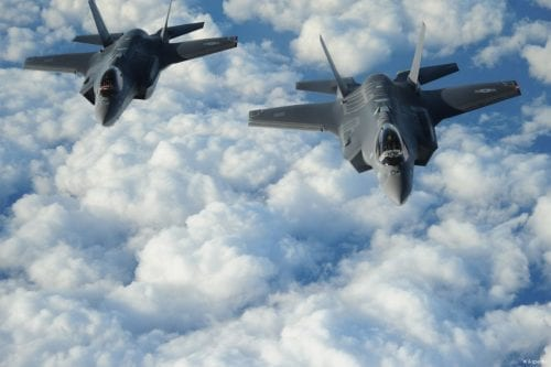 """Two US-made Israeli F-35 """"Adirs"""" fly in formation, and display the US and Israeli flags, en route to Israel for their delivery on December 6, 2016 [U.S. Air Force/Wikipedia]"""