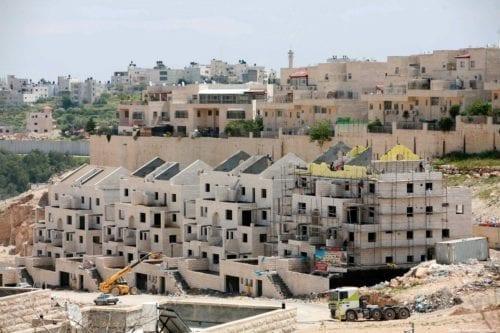 Construction workers build illegal settlements in Jerusalem [Sliman Khader/Apaimages]