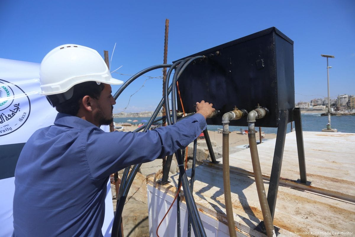 Due to the severe lack of electricity in Gaza, Palestinian engineers generate electricity using waves from the sea [Mohammed Asad/Middle East Monitor]