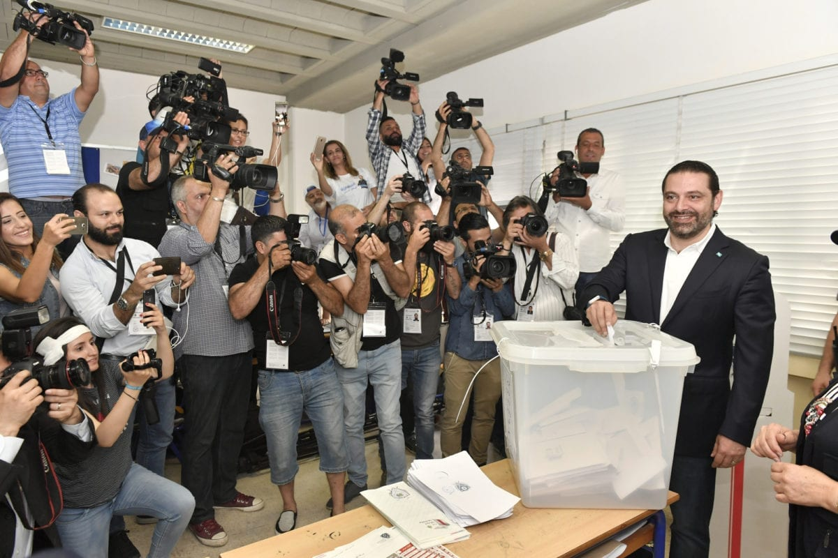 Lebanese Prime Minister Saad Hariri casts his vote at a polling station during Lebanese general election in Beirut, Lebanon on May 06, 2018 [Houssam Shbaro / Anadolu Agency]