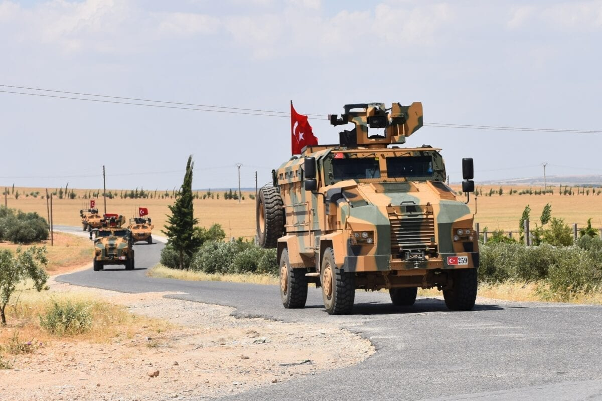 Armoured vehicles of Turkish Armed Forces are seen as they begin patrolling in northern Syria as part of the objective to rid the area of the YPG/PKK terror group on 20 June 2018 [Saher el Hacci/Anadolu Agency]