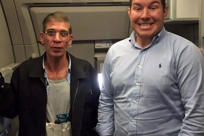 Seif Eldin Mustafa (left) seen with his fake explosive belt, takes a selfie with a passenger (right)