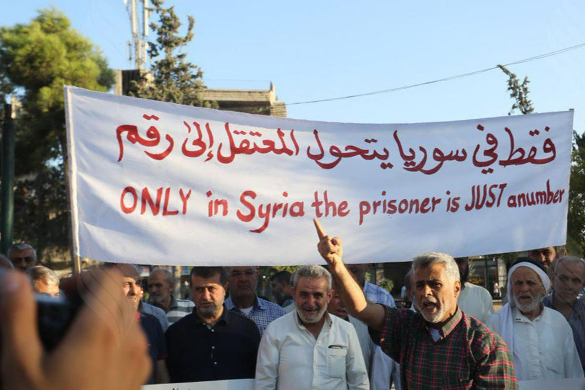 Demonstrators in Idlib, Syria, demanding justice for the thousand Syrian prisoners, tortured and killed in Assad's prisons [Twitter]