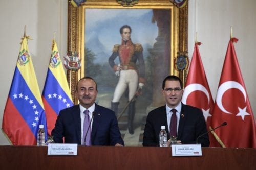 Turkish Foreign Minister Mevlut Cavusoglu (L) and Venezuelan Foreign Minister Jorge Arreaza Montserrat (R) sign the Collaboration of the Memorandum of Understanding in Caracas, Venezuela on 22 September 2018. [Cem Özdel - Anadolu Agency ]