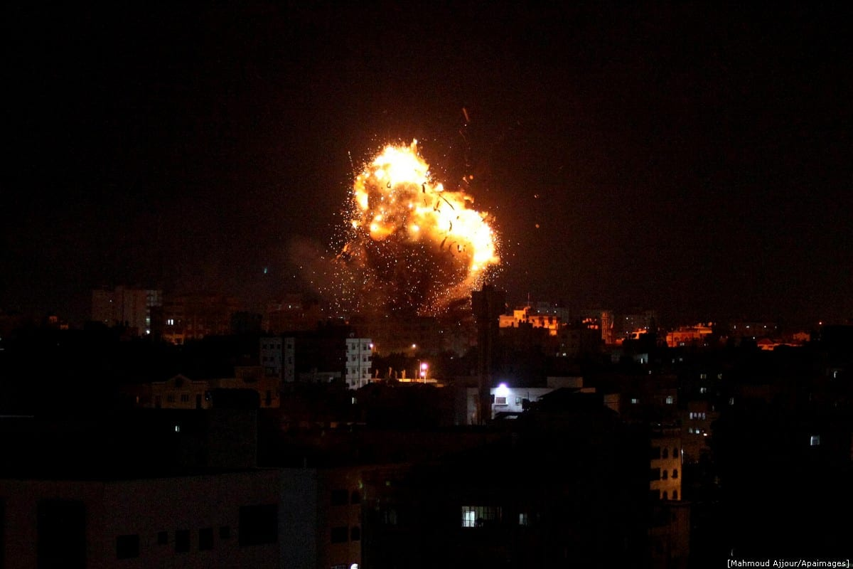 a ball of fire and smoke rise above the building housing the television station al-Aqsa TV during an Israeli air strike in Gaza City on 12 November 2018 [Mahmoud Ajjour/Apaimages]
