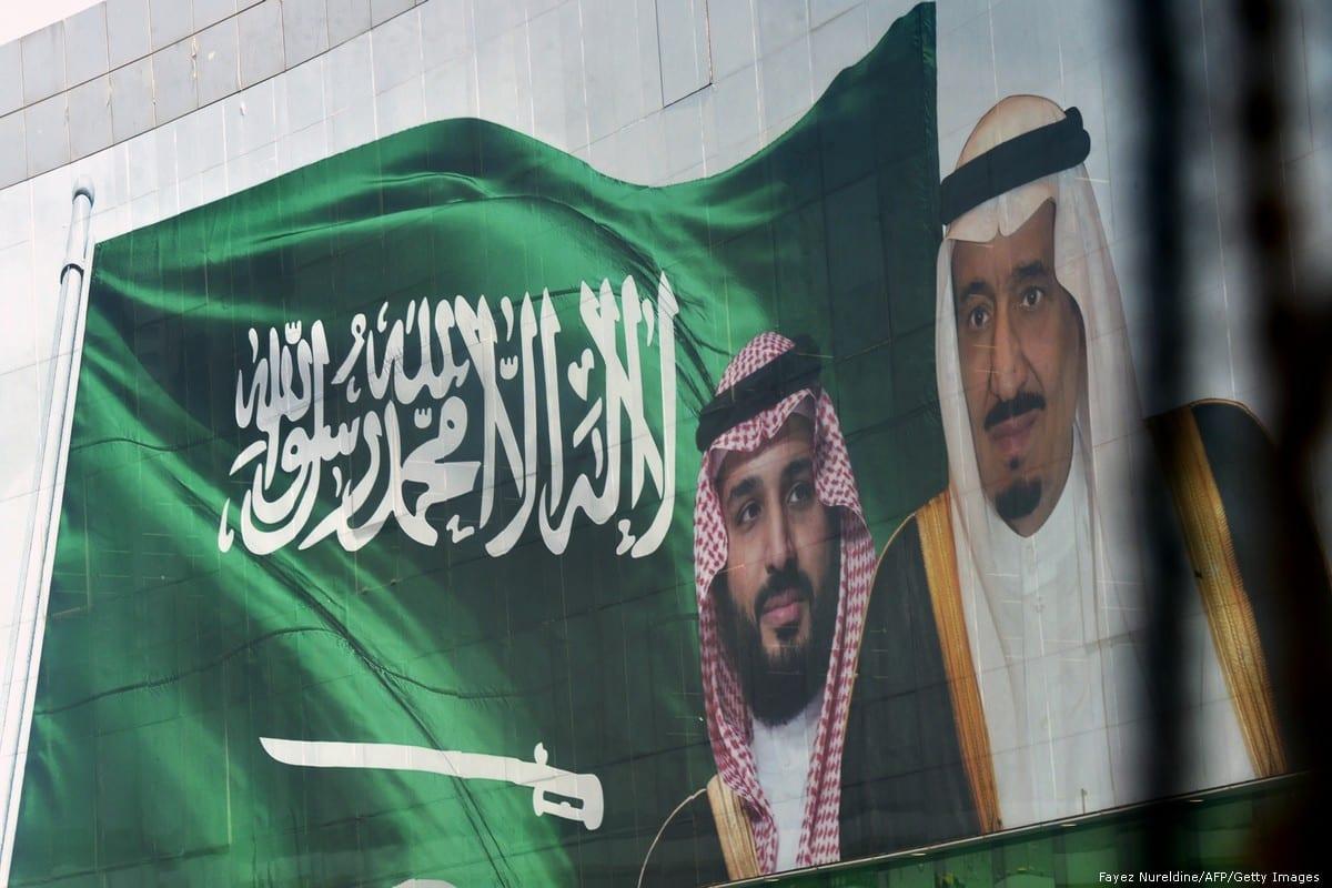 Portraits of Saudi King Salman bin Abdulazziz (R) and his son Crown Prince Mohammed bin Salman (L) are seen on 18 October 2018 in Riyadh, Saudi Arabia [Fayez Nureldine/AFP/Getty Images]