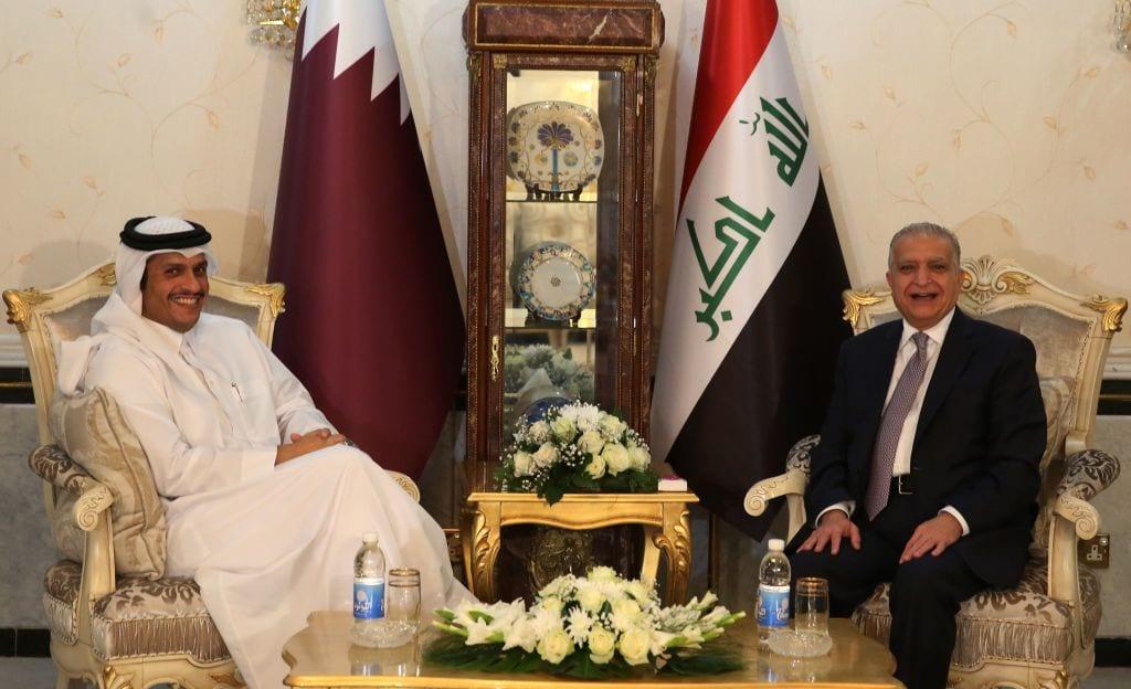 Iraqi Foreign Minister Mohammed Ali al-Hakim (R) meets his Qatari counterpart Mohammed bin Abdulrahman Al-Thani in the Iraqi capital Baghdad on November 7, 2018. (Photo by AHMAD AL-RUBAYE / AFP / Getty Images)