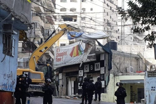 The occupying forces are launching demolitions for 16 commercial shops in the Shuafat camp in occupied Jerusalem [Facebook]