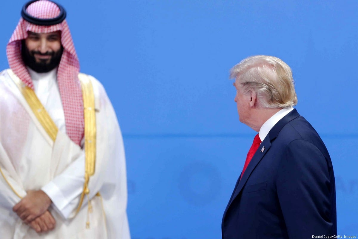 U.S. President Donald Trump looks over at Crown Prince of Saudi Arabia Mohammad bin Salman al-Saud as they line up for the family photo during the opening day of Argentina G20 Leaders' Summit 2018 at Costa Salguero on 30 November 2018 in Buenos Aires, Argentina. [Daniel Jayo/Getty Images]