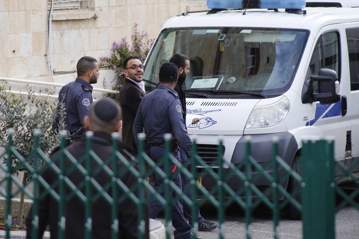 Jerusalem governor Adnan Ghaith (3rd R) is seen after Israeli court on Sunday ordered the release of him in Jerusalem on December 2, 2018 [Mostafa Alkharouf / Anadolu Agency]
