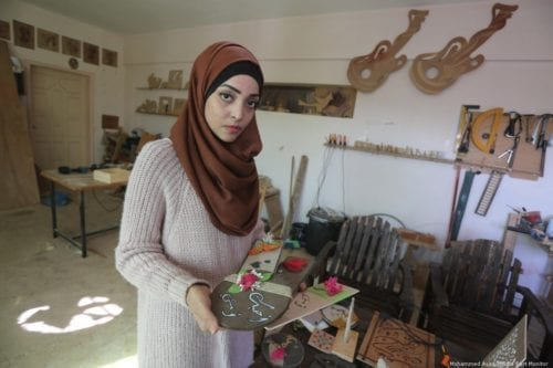 Walaa Abu Aisha, a Palestinian carpenter in Gaza [Mohammed Asad/Middle East Monitor]