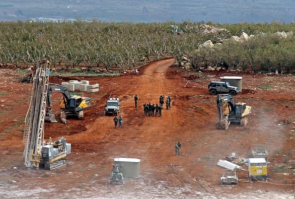Members of the Israeli military, excavators, trailers and other vehicles operating near the border of Lebanon on 5 December 2018 [Ali Dia/AFP/Getty Images]
