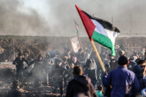 Israeli forces fire tear gas at Palestinians during the Great March of Return in Gaza on 11 January 2019 [Ali Jadallah/Anadolu Agency]