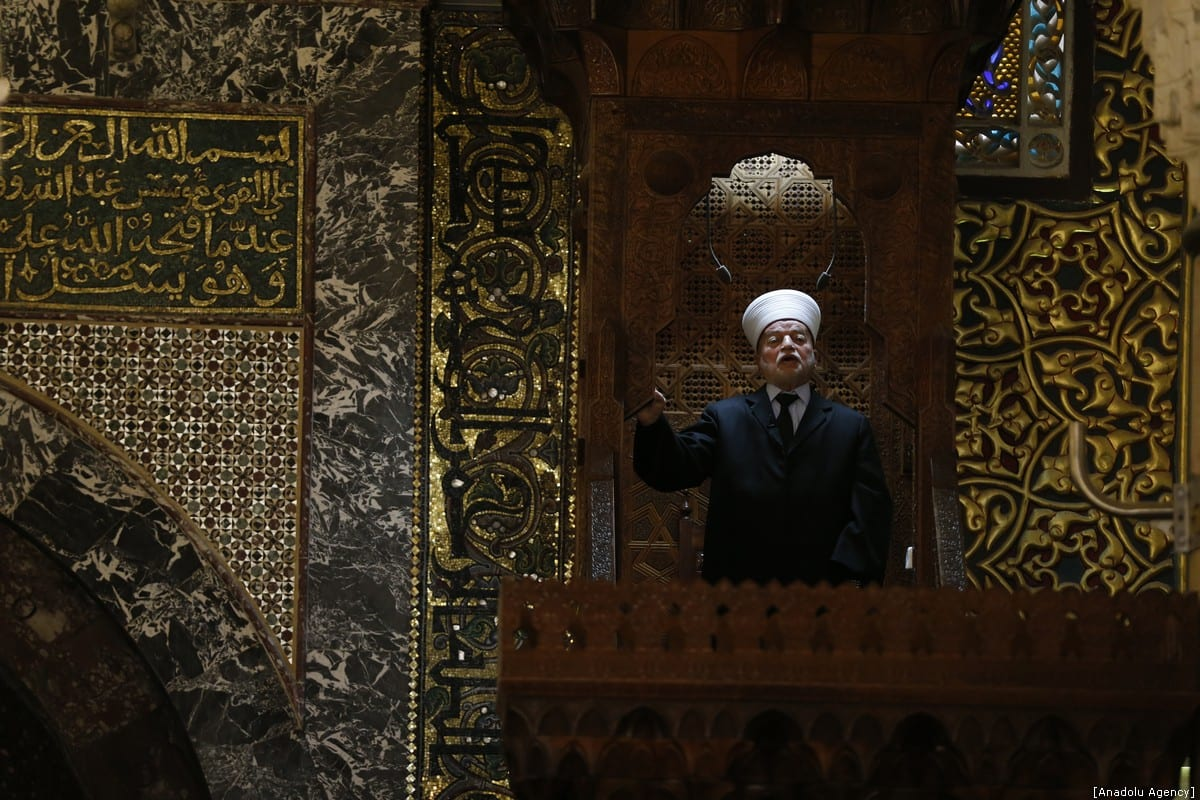 Jerusalem Mufti Sheikh Muhammad Hussein conducts a sermon (Khutbah) during the Friday prayer at Al-Aqsa Mosque Compound in Jerusalem on 4 January 2019 [Mostafa Alkharouf/Anadolu Agency]