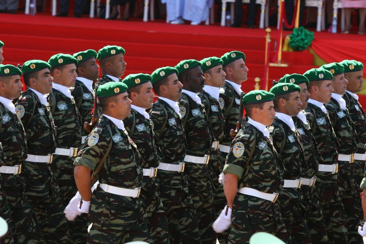 Moroccan soldiers march past the official stand during a military parade in Bobo Dioulasso on December 11, 2010, during celebrations marking its 50 years of independence from France [AHMED OUOBA/AFP/Getty Images]