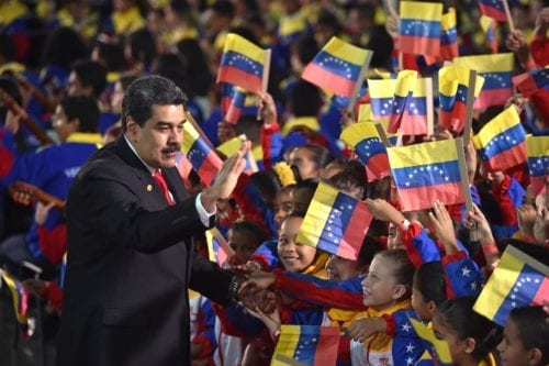 Venezuela's President Nicolas Maduro greets children upon arrival for the inauguration ceremony of his second mandate, at the Supreme Court of Justice (TSJ) in Caracas on January 10, 2019 [YURI CORTEZ/AFP/Getty Images]