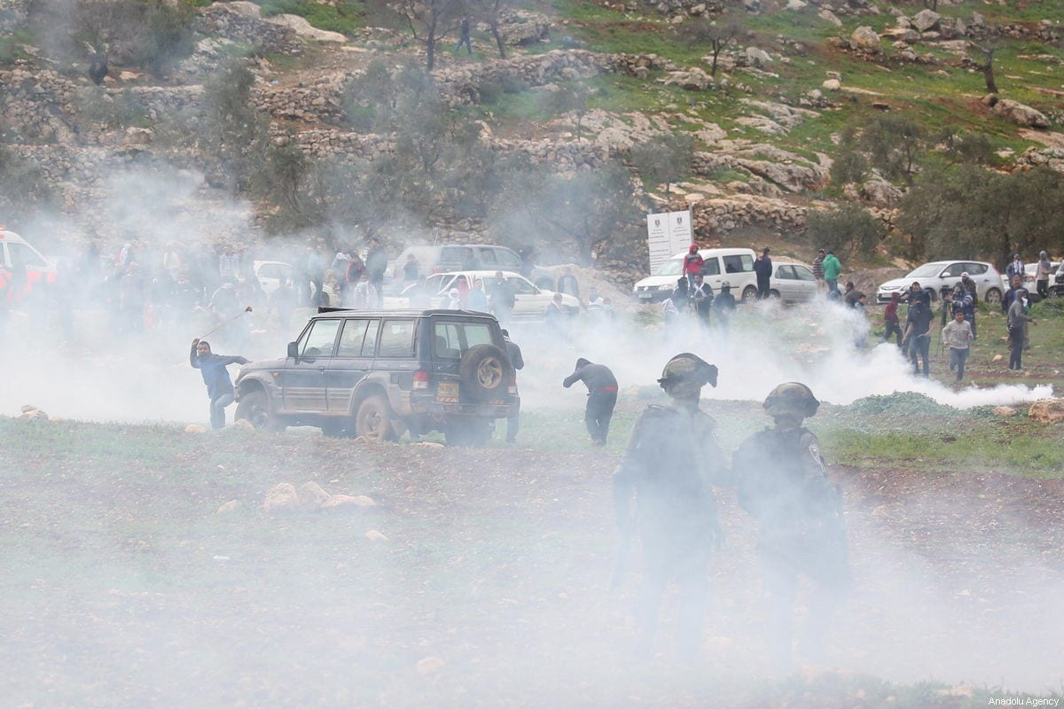 Israeli forces clash with Palestinians during a protest against excavation works on Palestinian lands, near an illegal Israeli settlement, in the town of al-Mughayyir, West Bank on February 01, 2019 [Issam Rimawi / Anadolu Agency]