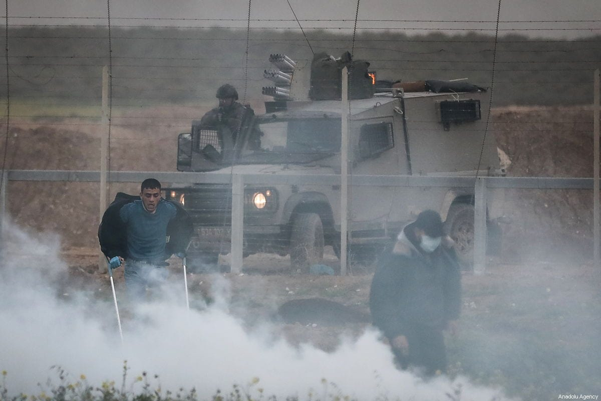 Israeli forces fire at Palestinians during the Great March of Return along the Gaza - Israel border on 15 February 2019 [Ali Jadallah/Anadolu Agency]